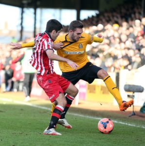 Cambridge captain Greg Taylor is expected to return from a hamstring injury in the League Two clash with Carlisle.