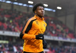 Kortney Hause admits he's desperate to play for Wolves in the Premier League but knows he will have to be patient.