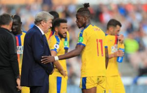 Roy Hodgson says he supports Wilfried Zaha's calls for him to receive better protection but won't be making an official complaint.