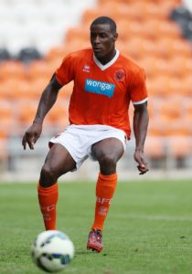 Blackpool will have Marc Bola available for the Sky Bet League One clash with Luton.
