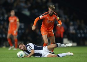 Midfielder Andrew Shinnie's first goal of the season was enough for Luton to beat Bristol Rovers 1-0 at Kenilworth Road.