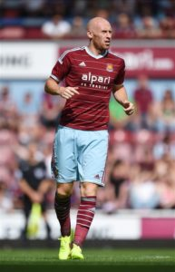 Former West Ham central defender James Collins is continuing to train with Ipswich Town but an injury is preventing him joining.