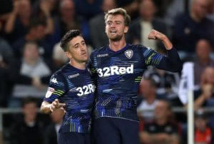 Championship leaders Leeds have been dealt a blow after forward Patrick Bamford was ruled out for four months with a knee injury.