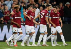 West Ham thrashed Macclesfield 8-0 as debutant Grady Diangana hit a double and Ryan Fredericks scored a stunner.