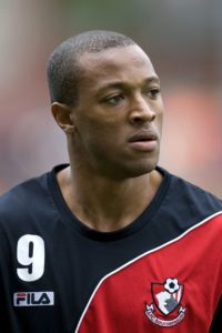 Goals from Wes Thomas and JJ Hooper saw Grimsby pick up their first home league win of the season as they beat Port Vale 2-0.