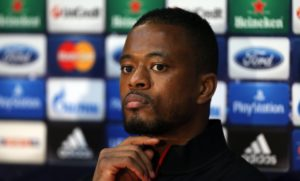 Patrice Evra's presence next to United vice-chairman for a third game running at Chelsea could spark more Zinedine Zidane rumours.