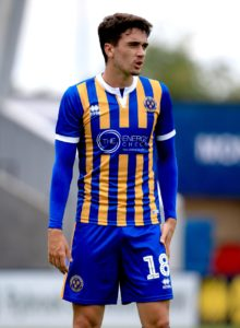 Alex Gilliead headed the winner as Shrewsbury beat 10-man Accrington 1-0 to register a second League One victory of the season.