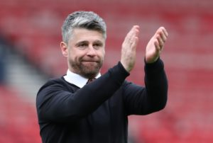 Motherwell manager Stephen Robinson praised his side's character after they earned a 1-1draw against Livingston with 10 men in the Ladbrokes Premiership.