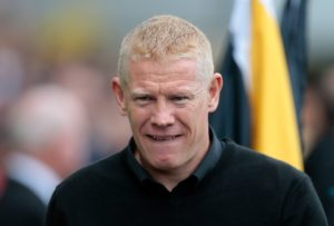 Livingston manager Gary Holt has warned they will have to battle against a Dundee team keen to impress his former team-mate Jim McIntyre.