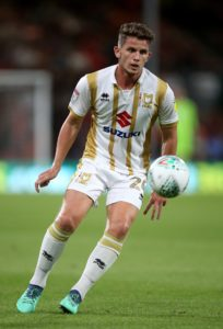Mansfield and second-placed MK Dons had to settle for a 1-1 draw at Field Mill.