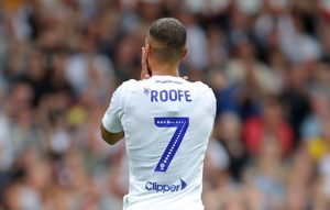 Leeds are looking to tie down striker Kemar Roofe to a new deal with Premier League clubs starting to take interest.