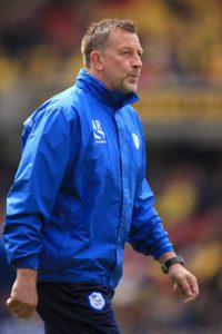 Oldham have terminated the contract of assistant manager Andy Rhodes, the Sky Bet League Two club have announced.