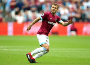 Jack Wilshere has suffered another injury setback as he struggles with an ankle problem, but Andy Carroll is back in training.