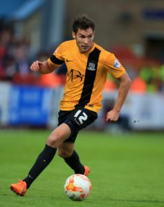 Mansfield midfielder Will Atkinson is available again after a ban for Saturday's game against MK Dons.