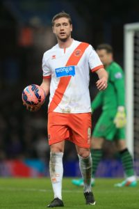 Striker Steven Davies could be involved in Blackpool's squad for the game against AFC Wimbledon.