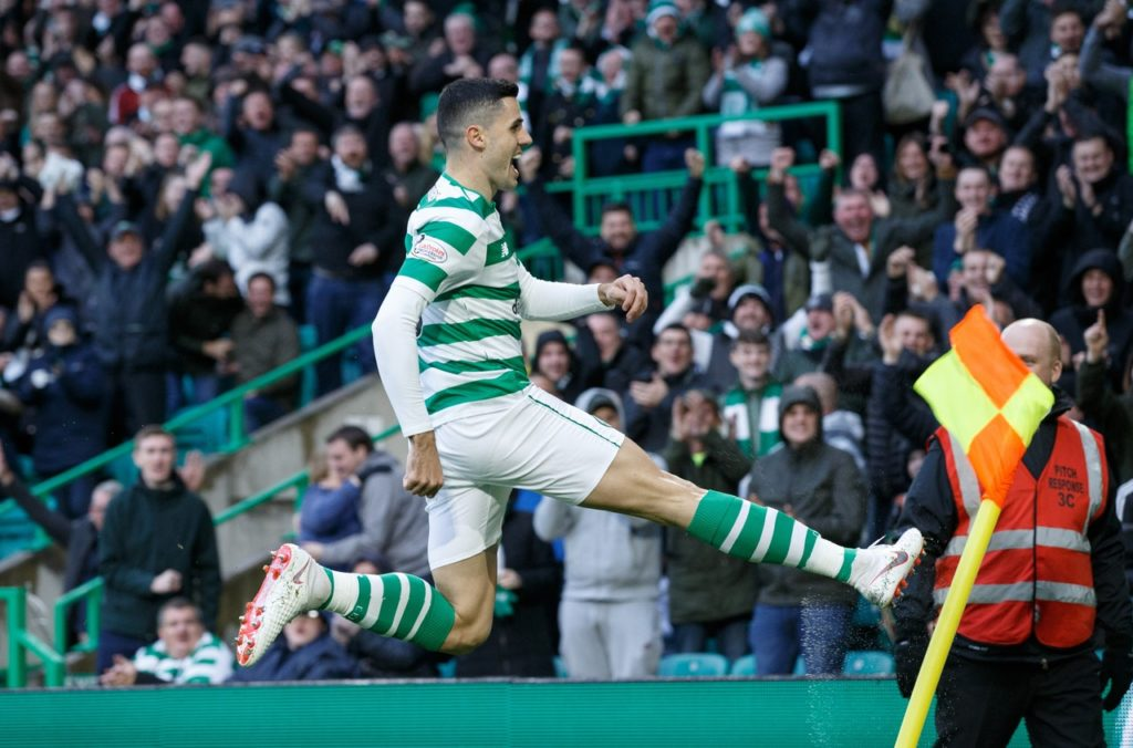 Celtic moved into second place in the Ladbrokes Premiership with a frenetic 4-2 win over Hibernian at Parkhead.