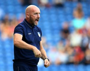 Colchester maintained their impressive start to the season with a battling 1-0 victory against injury-hit Morecambe.