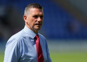 Shrewsbury manager John Askey was a happy man after Alex Gilliead's first goal for the club sealed a 1-0 victory over 10-man Accrington.