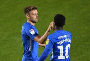 Peterborough striker Matt Godden returned to haunt former club Scunthorpe as his second-half double earned his side a 2-0 win at Glanford Park.