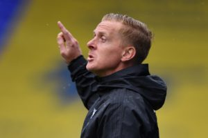 Boss Garry Monk played down Birmingham's top-six credentials after they extended their unbeaten run to 10 games with a 2-1 victory over Reading.