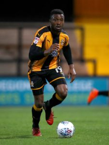 Cambridge will have defender Brad Halliday available again following suspension for the Sky Bet League Two match against bottom club Macclesfield.