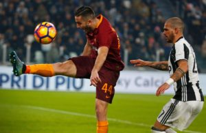 Roma defender Kostas Manolas admits he nearly left the club but insists he finds it hard to move away from the Italian capital.
