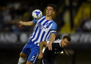 Brighton boss Chris Hughton is confident defender Lewis Dunk will take inspiration from his experience with England.
