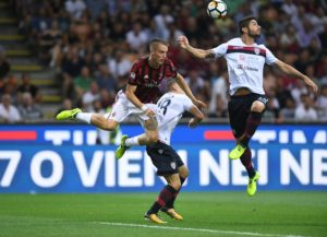 Milan defender Andrea Conti is back in training following a serious knee injury and will return to action soon, his agent says.