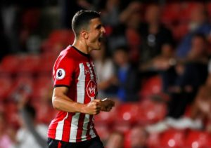 Southampton winger Mohamed Elyounoussi says he is struggling with an ankle problem but insists he will still turn out for Norway.