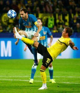 Diego Godin has called on his Atletico Madrid teammates to improve after the 4-0 Champions League thrashing at Borussia Dortmund.