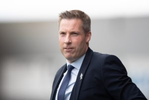 Millwall boss Neil Harris says he is yet to make the call on who will replace Ben Amos for Saturday's game against Bolton.
