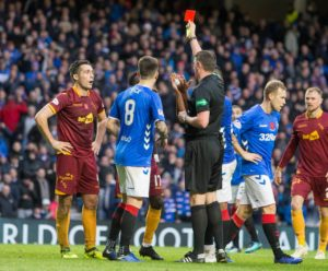 Motherwell had midfielder Carl McHugh and manager Stephen Robinson sent off as they crashed to a 7-1 defeat against Rangers at Ibrox.