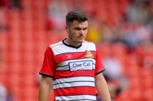 Tommy Rowe returned from a 10-week absence to net a late winner in a 2-1 victory for Doncaster which piled more misery on managerless AFC Wimbledon.