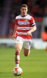 Former Premier League defender Shaun Cummings could feature for Doncaster against AFC Wimbledon.