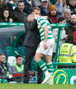 Former Celtic forward John Hartson feels Scott Brown deserves an immediate return to the starting line-up when he shakes off an injury.