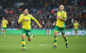 Norwich cemented their place at the top of the Championship table with a ruthless 4-1 victory at Swansea.