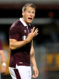 Craig Levein is ready to fire a shot across Rangers' bows by pitching Hearts skipper Christophe Berra back into battle at Tynecastle on Sunday.