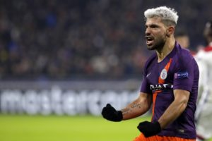 Aymeric Laporte and Sergio Aguero struck as Manchester City twice came from behind to qualify for the Champions League last 16 with a 2-2 draw at Lyon.