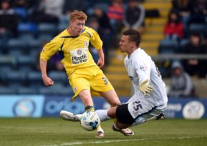 Defender Brad Halliday could be a doubt when Cambridge host Bury in League Two.