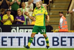 Jordan Rhodes and Teemu Pukki struck in stoppage time as Norwich recorded an incredible 4-3 victory over Millwall at Carrow Road in the Championship.