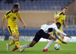 Oxford secured an FA Cup second-round date with Plymouth after goals from James Henry, Jamie Mackie and Marcus Browne earned a 3-0 win at Forest Green.