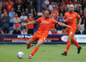 Ten-man Luton held on to secure a point from a goalless Sky Bet League One draw at Rochdale.