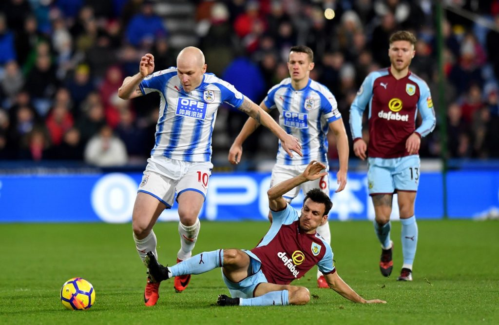 Huddersfield's Aaron Mooy, Steve Mounie, Jonas Lossl, and Mathias Jorgensen have all been called up for international duty next week.