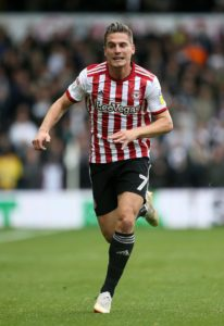 Brentford ended a nine-game winless run with a hard fought 2-0 derby success over Millwall thanks to second half goals from Sergi Canos and Ollie Watkins.