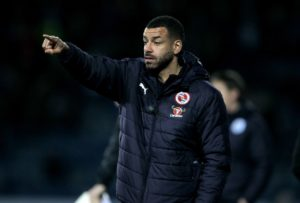 AFC Wimbledon interim manager Simon Bassey has added Steven Reid to his first-team coaching staff.