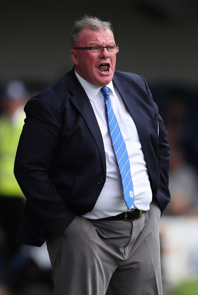 Peterborough manager Steve Evans has become the first boss to be suspended in a Football Association crackdown on misconduct in the technical area.