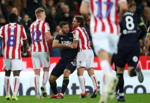 Derby midfielder Bradley Johnson has been handed an increased four-match ban for allegedly biting Stoke's Joe Allen, the Football Association has announced.