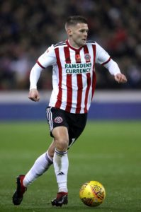 Sheffield United stayed in touch with the Championship's top two with a 3-2 win at strugglers Brentford.