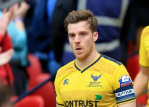 Cheltenham boss Michael Duff hopes to have defender Johnny Mullins available for the home clash with Newport.