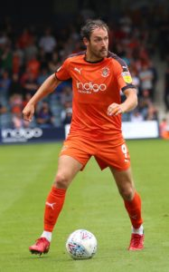 Luton will be without the suspended Danny Hylton for Saturday's FA Cup first-round home clash with Wycombe.